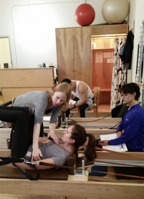 Halle Clarke and Elizabeth Shah of Thrive PT going over Pilates moves on the reformer